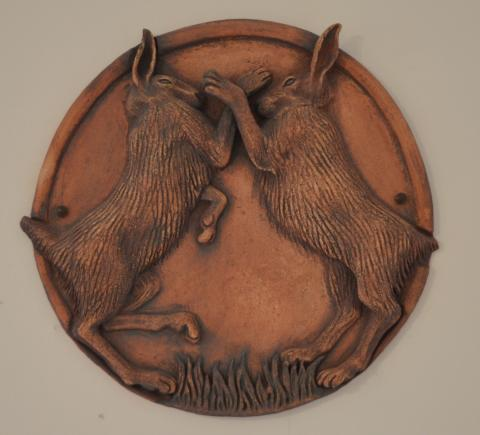a pair of boxing hares