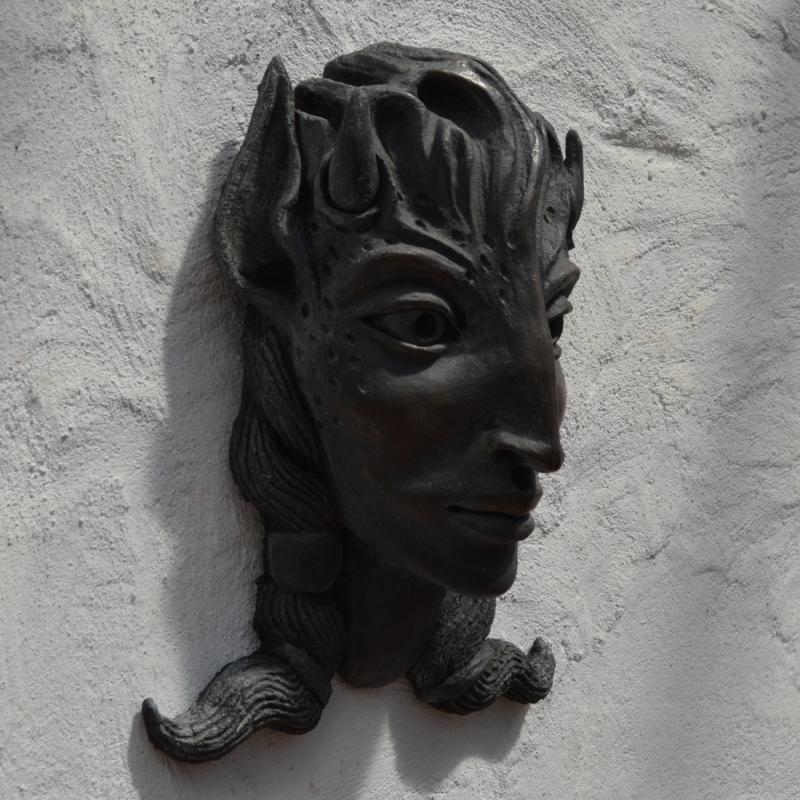 a bronze faun head