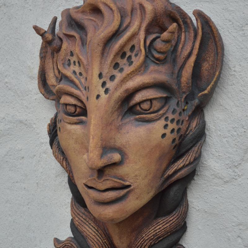 faun head on wall
