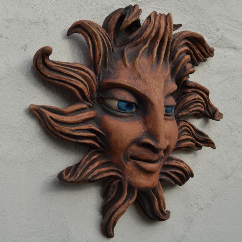 helios head on wall